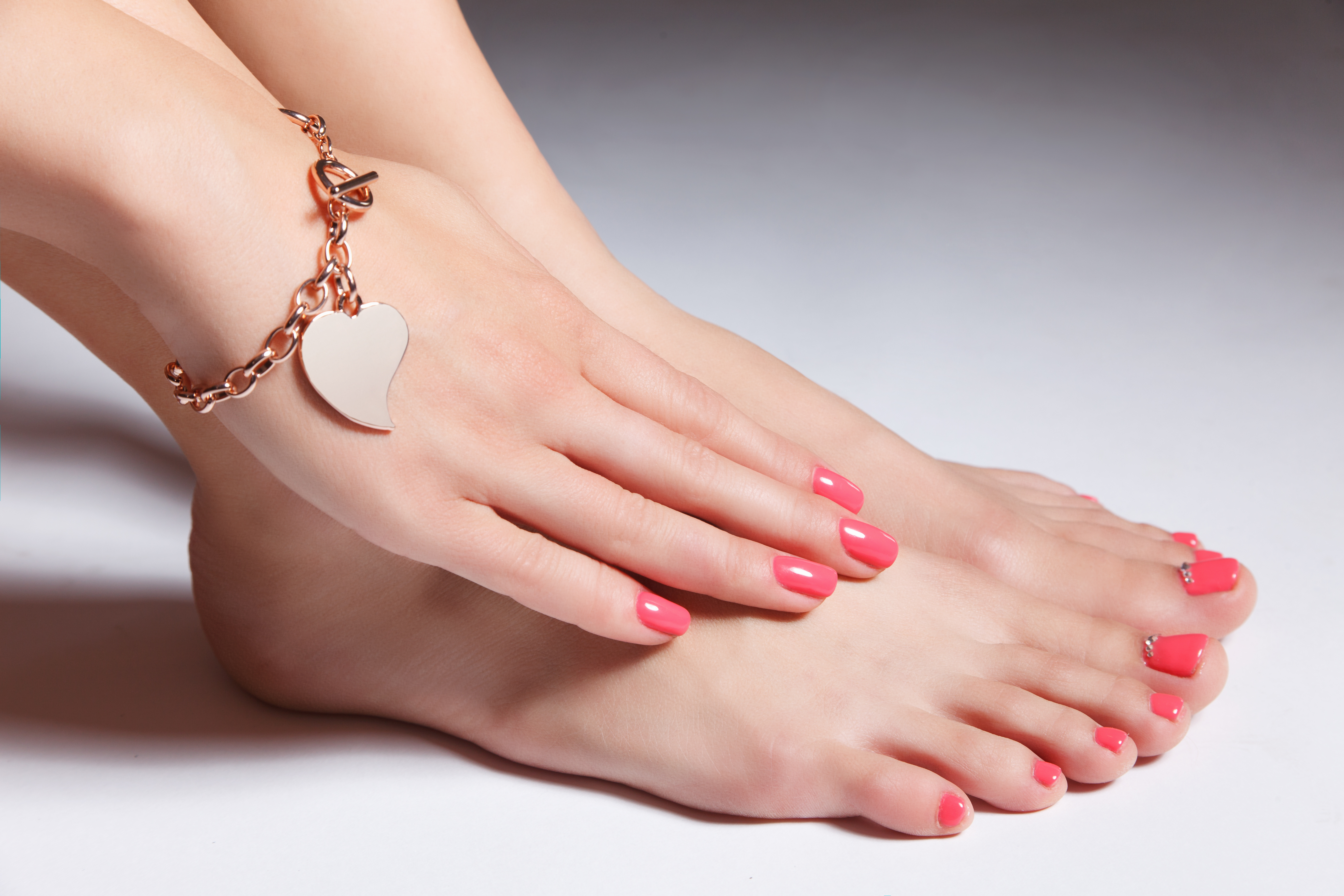 https://0901.nccdn.net/4_2/000/000/001/17f/Canva---Manicured-nails-and-pedicured-toes-with-gel-polish-5616x3744.jpg