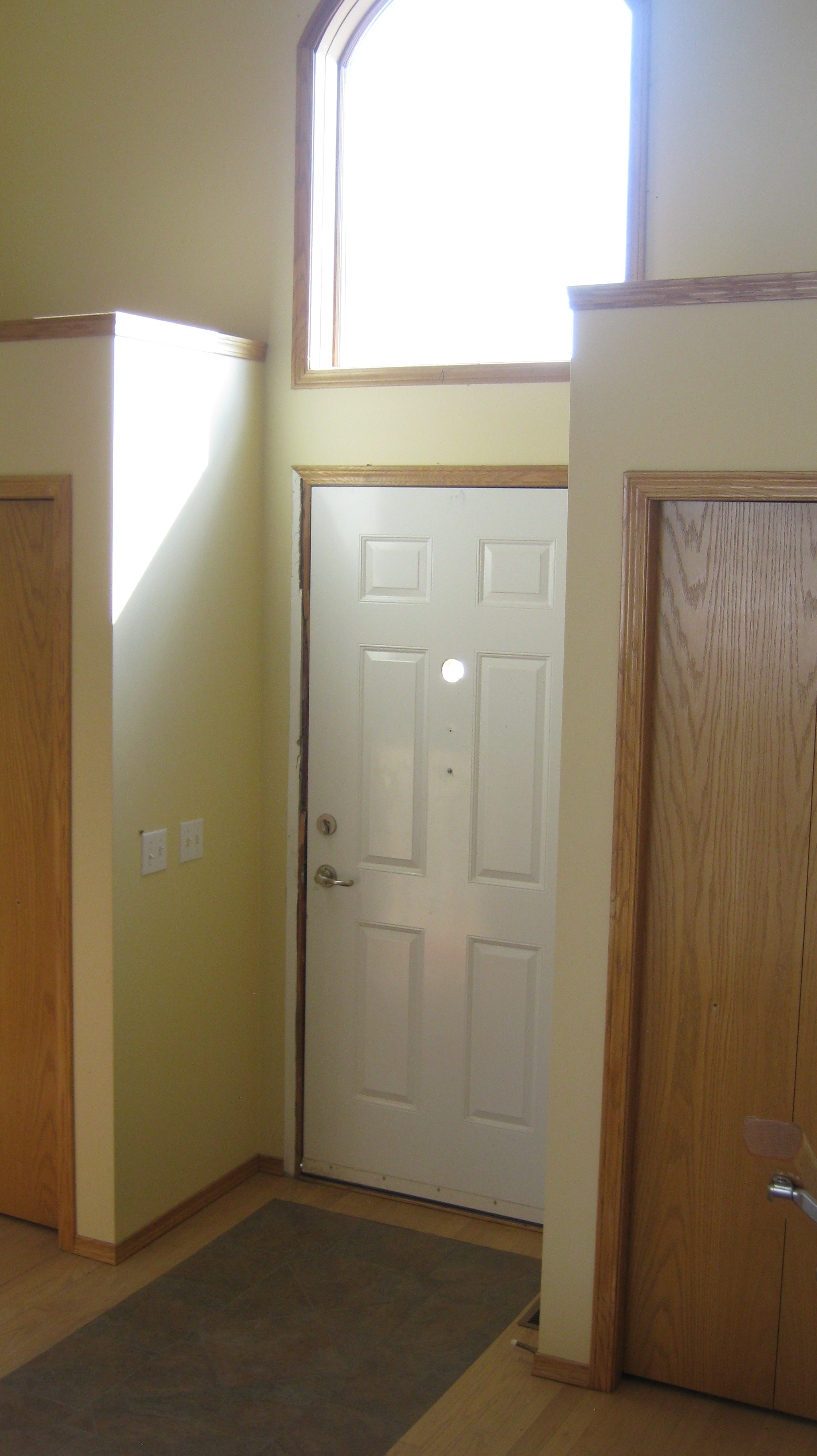 Front door with two closets on either side of door