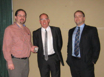 Chapter President Kevin Clannon (L) thanks Steve Morrison and David Schofield of National Bank following their presentation at the February Chapter meeting