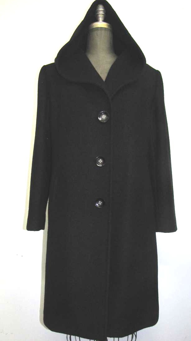 Style #4055-6 Black - Cashmere Wool.  Features:  Knee length coat with a an oversized hood. Single breasted style.  Roomy. comfortable coat which is great if you like to layer.     Fully chamois lined.  Includes extra Buttons.  In-Stock Colours:  Black, Plum, Camel, Black Tweed, Indigo, Stone, Dark Navy, Rust, Sangria, Navy.  Size: S, M, L  Price:  $525 and up
