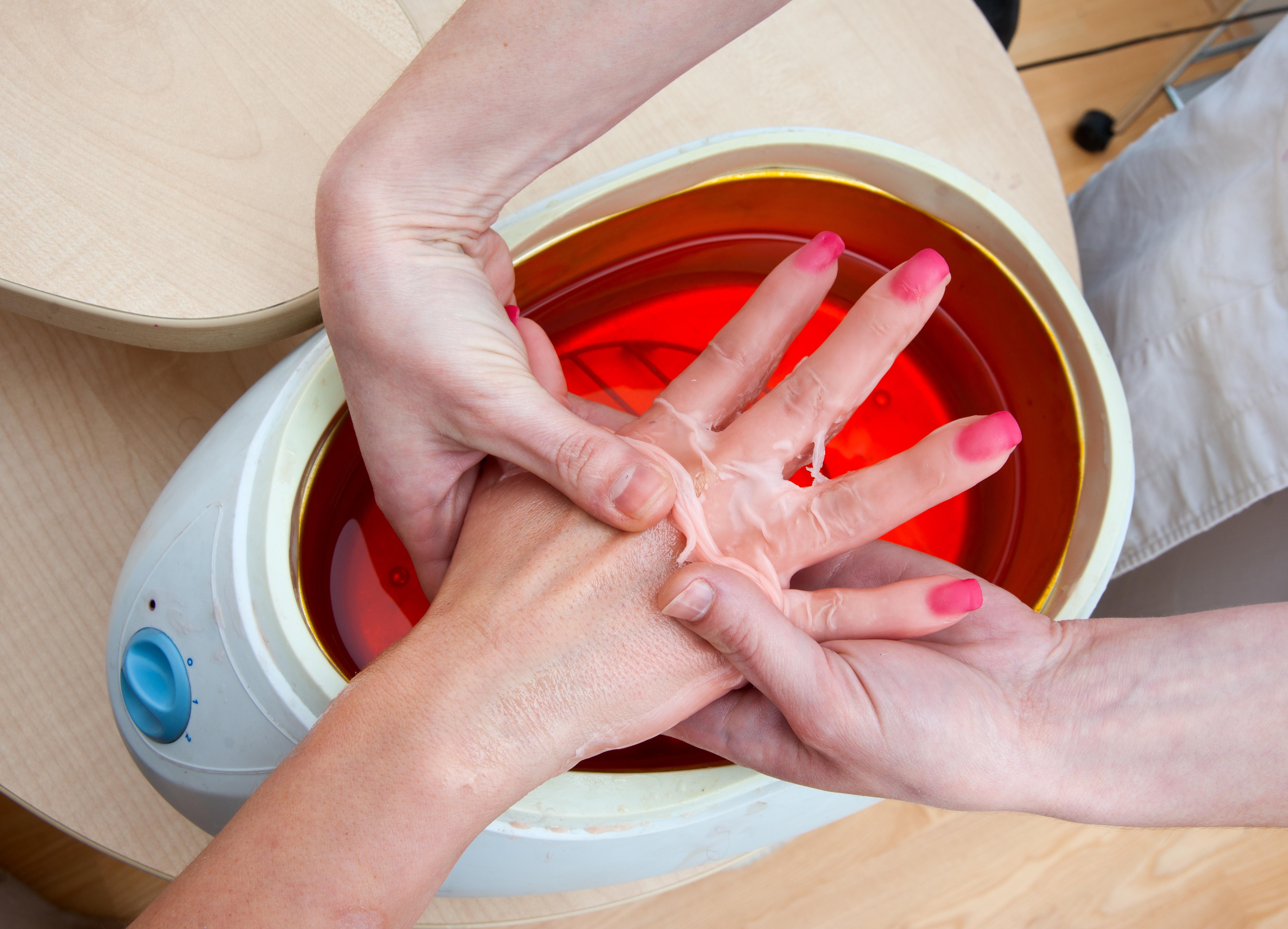 https://0901.nccdn.net/4_2/000/000/008/486/Canva---woman-hand-in-paraffin-bath.jpg