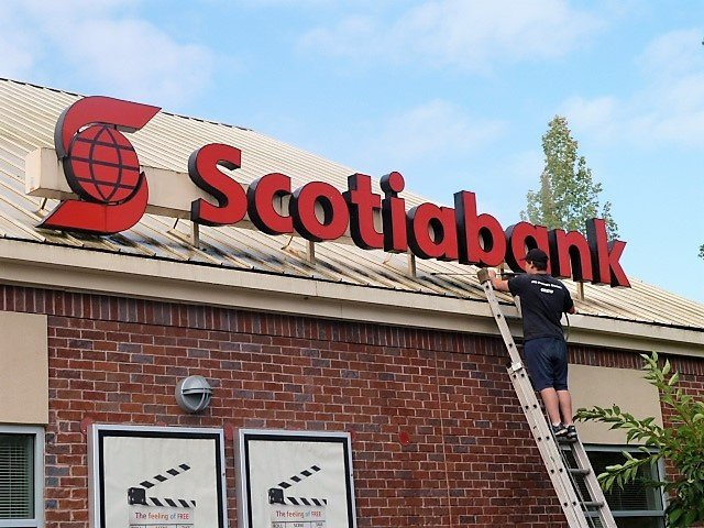 brush wash Scotiabank signs