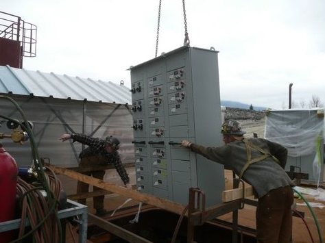 Electrical Switchboards being lowered into the vessel.