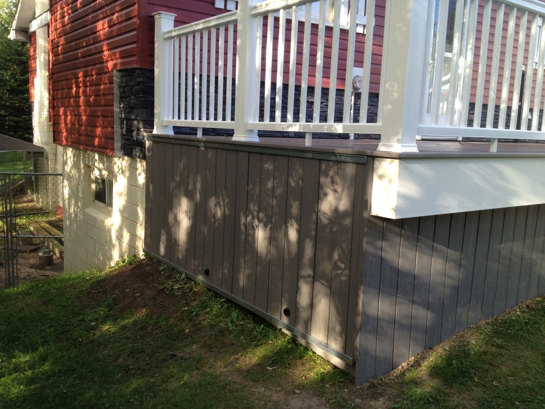 Composite deck with concealed storage