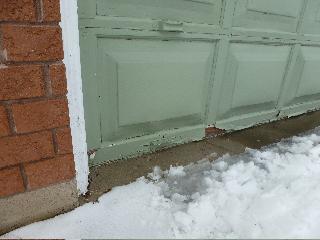 Needs Paint / Swollen Garage Door