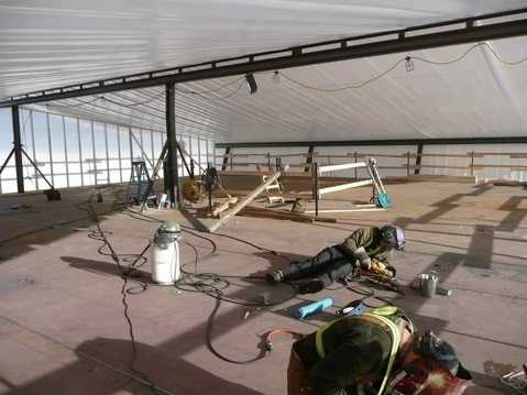 Welding the seams on the car deck.