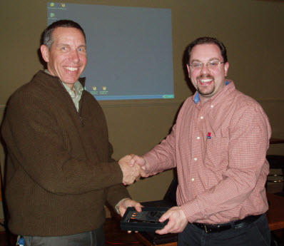 Chapter President Kevin Clannon (R) presents Eben Creaser with a token of the Chapter's appreciation following Mr Creaser's presentation at the January meeting