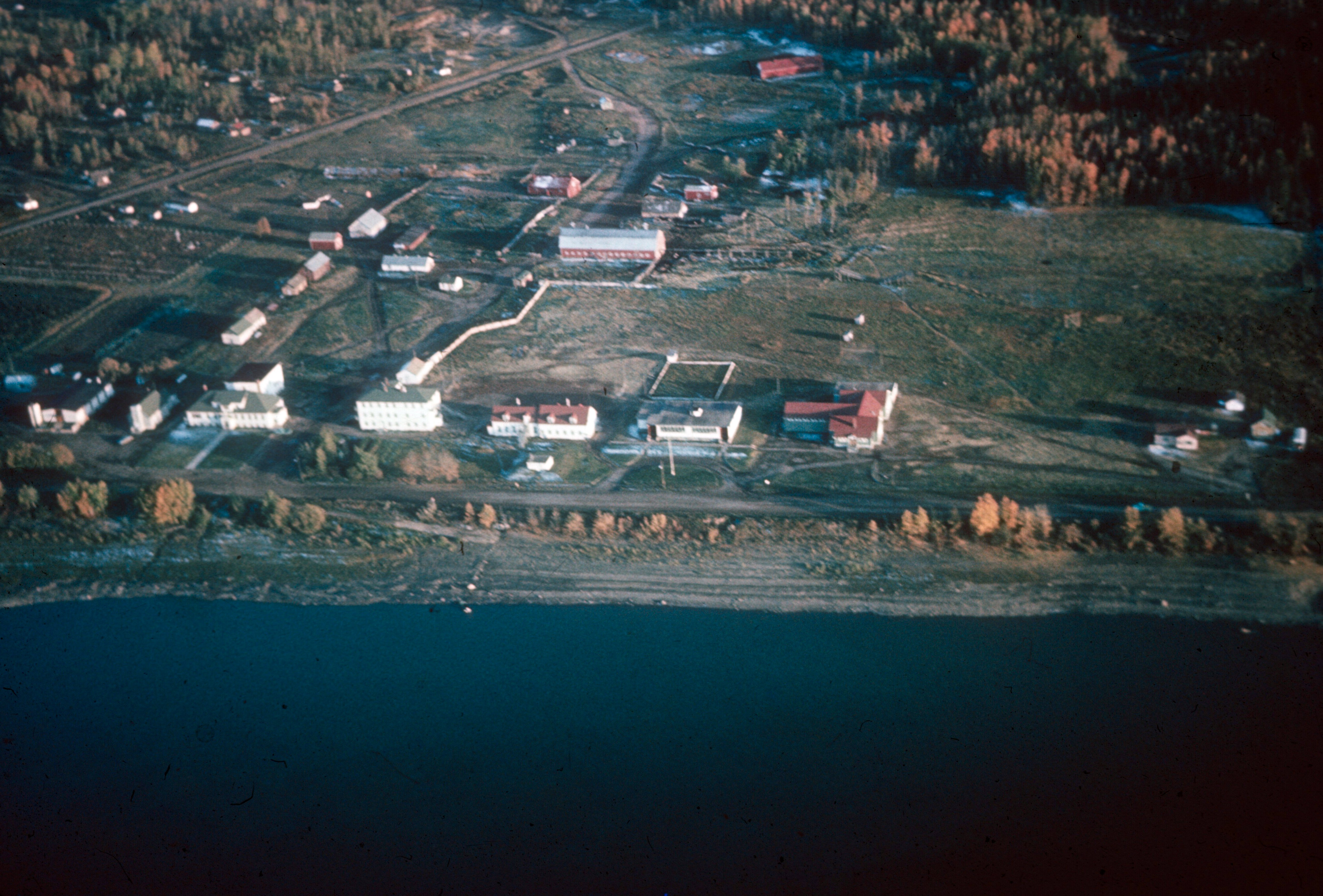 Aerial view of Fort Vermilion 1966. The buildings at centre are the public school and residential school with residences.  Photo Credit: Anthony  O'Carroll.