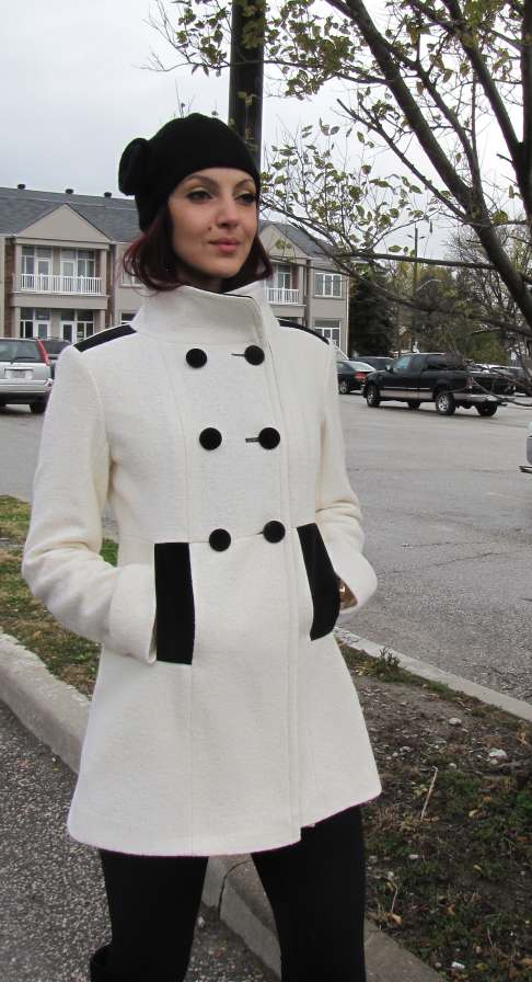 Style # 6605 - Winter White 100% Pure Virgin Wool-Boiled Wool  Features:  This women's Pea Coat updates the classic sailing version with its soft and supple velvet trim.    Welt pockets and shank buttons offer an element of heritage and sophistication. This is a jacket for all occasions: running around in the city or relaxed country weekends.  Available Fabrics:  Boiled Wool, Cashmere/Wool, 100% Pure Virgin Wool, Alpaca Wool and more  In-stock Colours: Mauve, Grey   Sizes: S, M, L  $ 389 - SALE - $ 159
