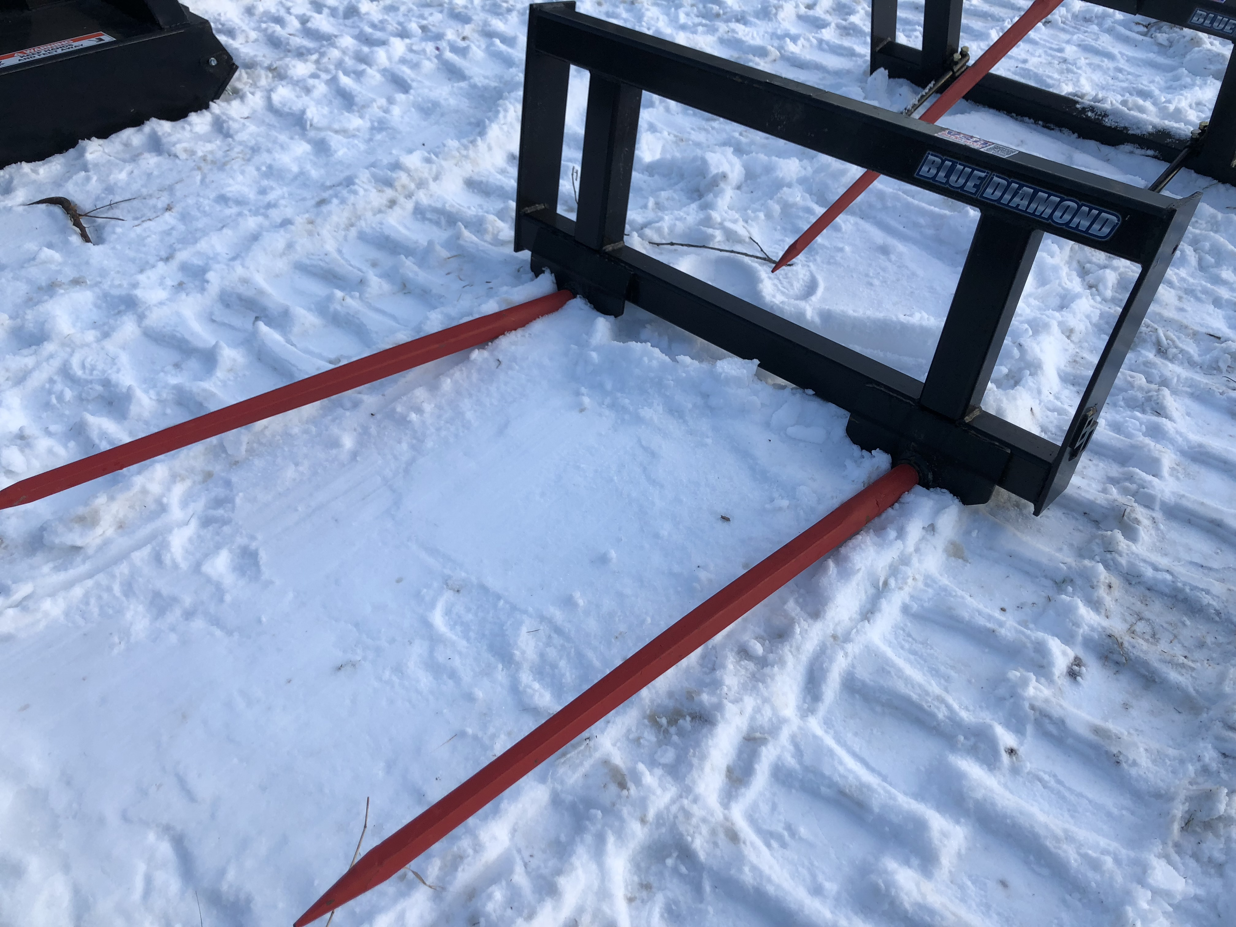 "Hay spear with 48"" tines Each tine can hold 3500 lbs,  extremely tough for long lasting  durability Move round and square bales Can be used for pallets Bolt on rack is available"