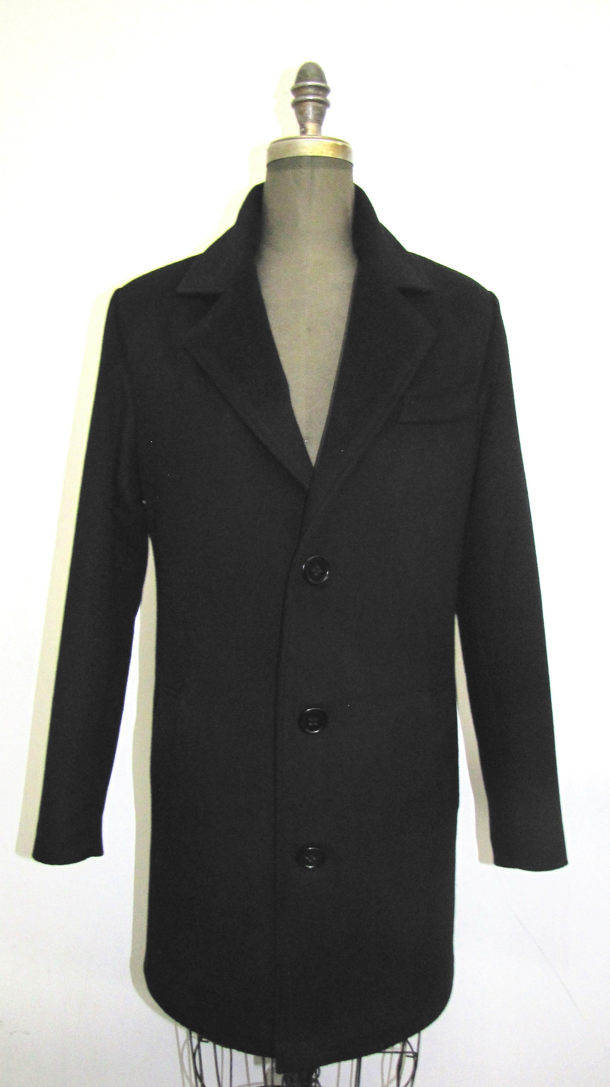 Style # M500 - Black Cashmere & Wool  Features:  Elevate your smart and casual looks  with this wool blend overcoat. Notched collar, breast pocket single breasted , three button fastening,  and centre vent for ease of movement.  In-Stock Colours: Black, Navy, Charcol  Sizes: S, M, L  Price:  $ 499 and up