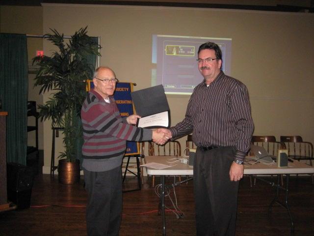 Dwight Scott 2012/2013 President presenting Gerry Waselynchuk the ASHRAE Service Award