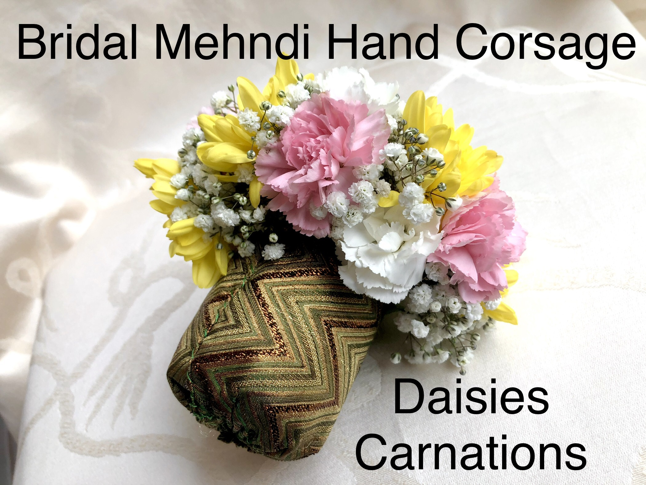 https://0901.nccdn.net/4_2/000/000/01e/20c/bridal-mehndi-hand-corsage-daisies-and-carnations.jpg