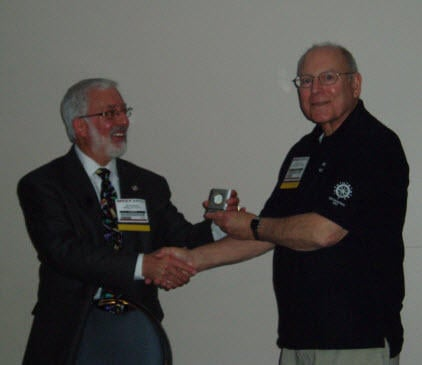 Chapter President-Elect Dwight Scott (R) presents ASHRAE Distinguished Lecturer James Newman with a small gift following his seminars at the MEET Show in May
