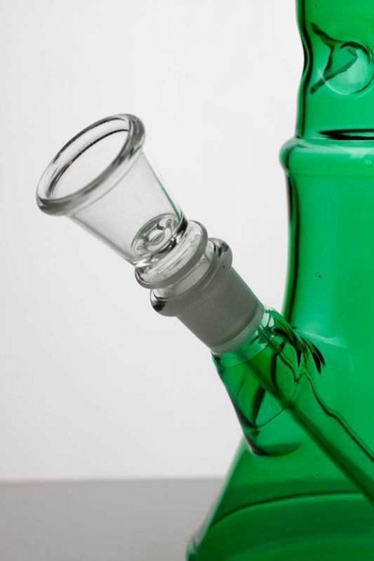 10 in. Green glass bong SKU:3531 Simple. Elegant. Classy. These are the three words which can be best used to describe the beaker glass bong. Latest in its line of glass bong products for weed smokers, you get one amazingly ornate bong with the beaker glass bong. At a reasonable size of 10 inches in height with a detachable downstem and an ice catcher, the beaker glass bong is bound to make your weed smoking experience nothing short of ethereal. Go ahead, what are you waiting for? You won't get a better bong than this, folks