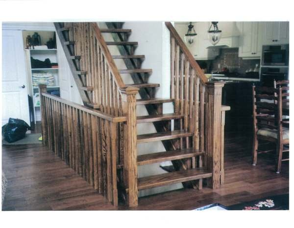 Straight red oak Scandinavian style stair with open stringers