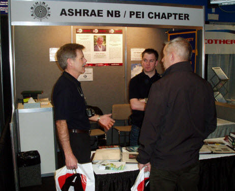 Chapter Executive members John Willden (L) and Kevin Leger (C) man the ASHRAE booth at the MEET Show