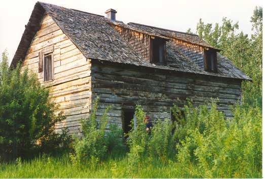 Anglican Mission House (c. 1876 oldest building in Mackenzie County) at Lambert Point. Photo Credit: Marilee Cranna Toews