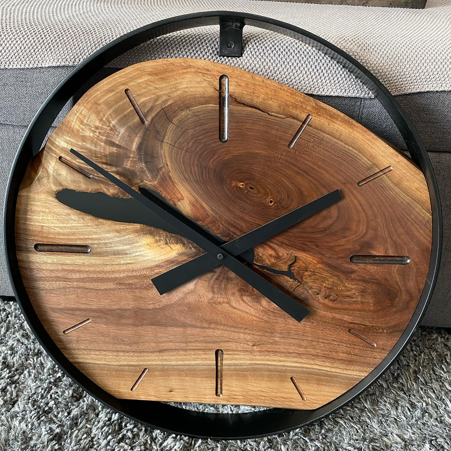 """20"""" Walnut Wall Clock.  The grain work on this particular piece of Walnut is perfectly paired with chunky clock hands and Router-trimmed, Epoxy Resin hour markings. A High Torque mechanism completes the package. $229"""