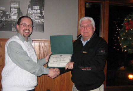 Chapter President Kevin Clannon (L) presents Gary Hoadley with an ASHRAE Service Award at the December Chapter Meeting