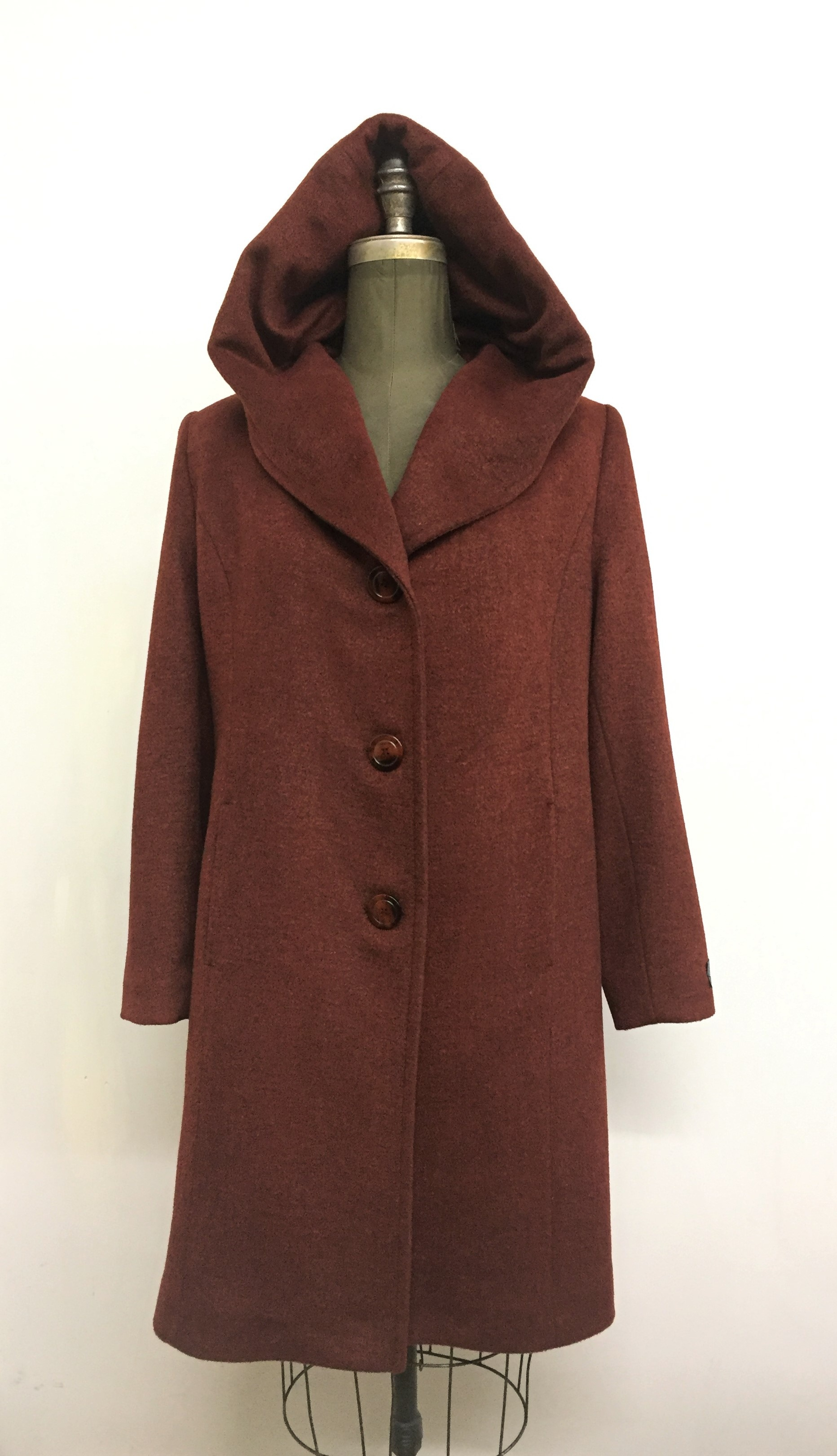Style #4405-13   Sunset Cashmere & Wool   Features:  Generous fit. Cozy and warm is how you'll feel. Knee length, single breasted coat with plenty of room  for layering.  Over-sized hood which extends into  at neckline.  Includes extra buttons. Chamois lined for warmth.  Available Fabrics:   Cashmere or Cashmere Blend, Alpaca, 100% Pure Virgin Wool and more.  In-Stock Colours: Black, Dark Navy, Rust, Plum, Camel,  Black Tweed, Indigo, Stone, Sangria, Navy or  can be custom made in any colour or fabric.  Size: S,M,L  Price:   $ 549 and up