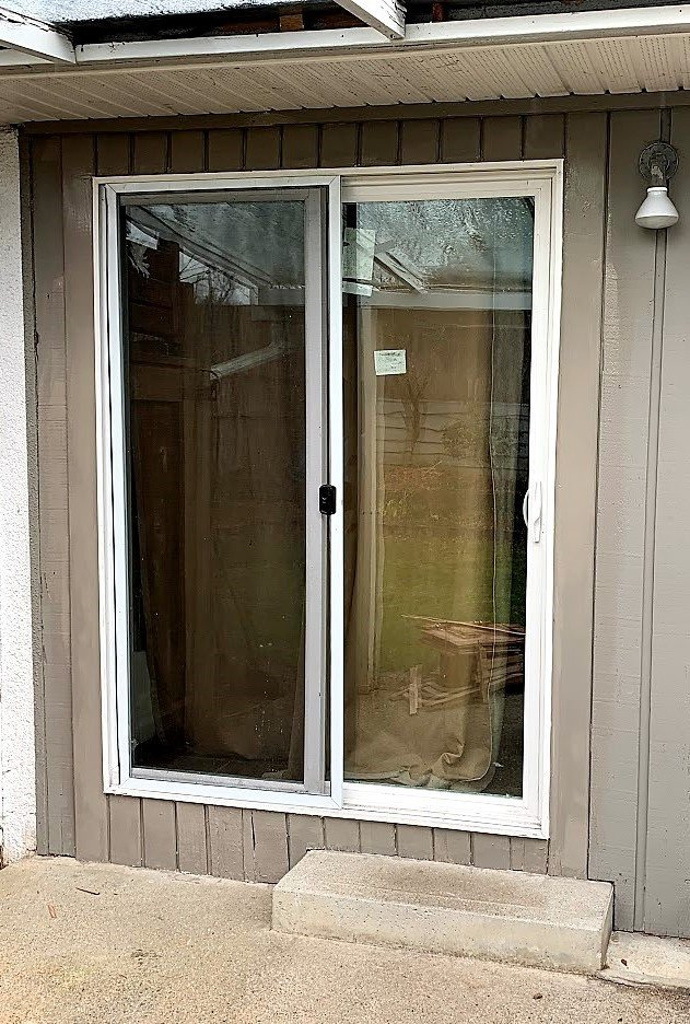 New tempered glass energy efficient patio door and screen installed.