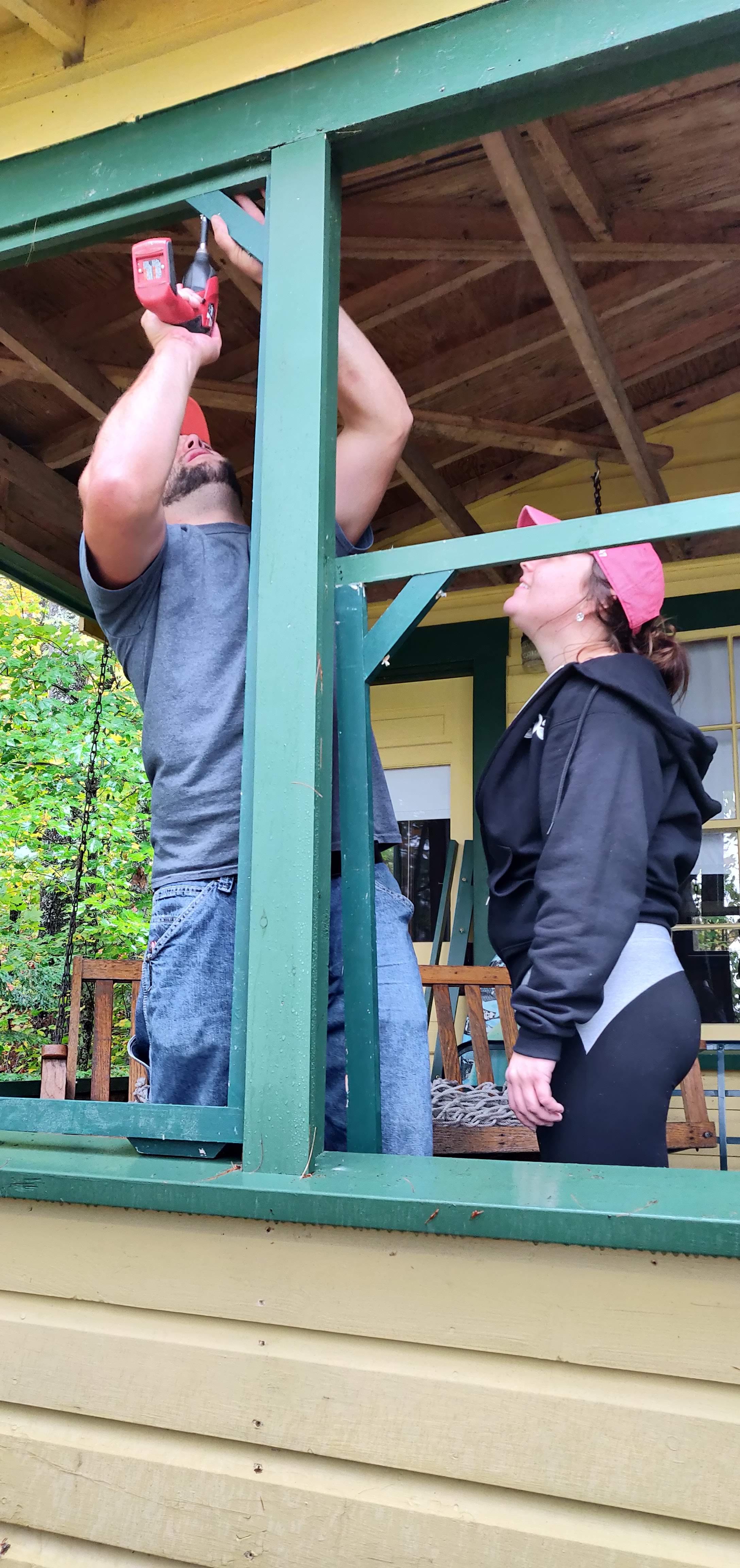Emily and Joe assembling frames for the winter shutters.