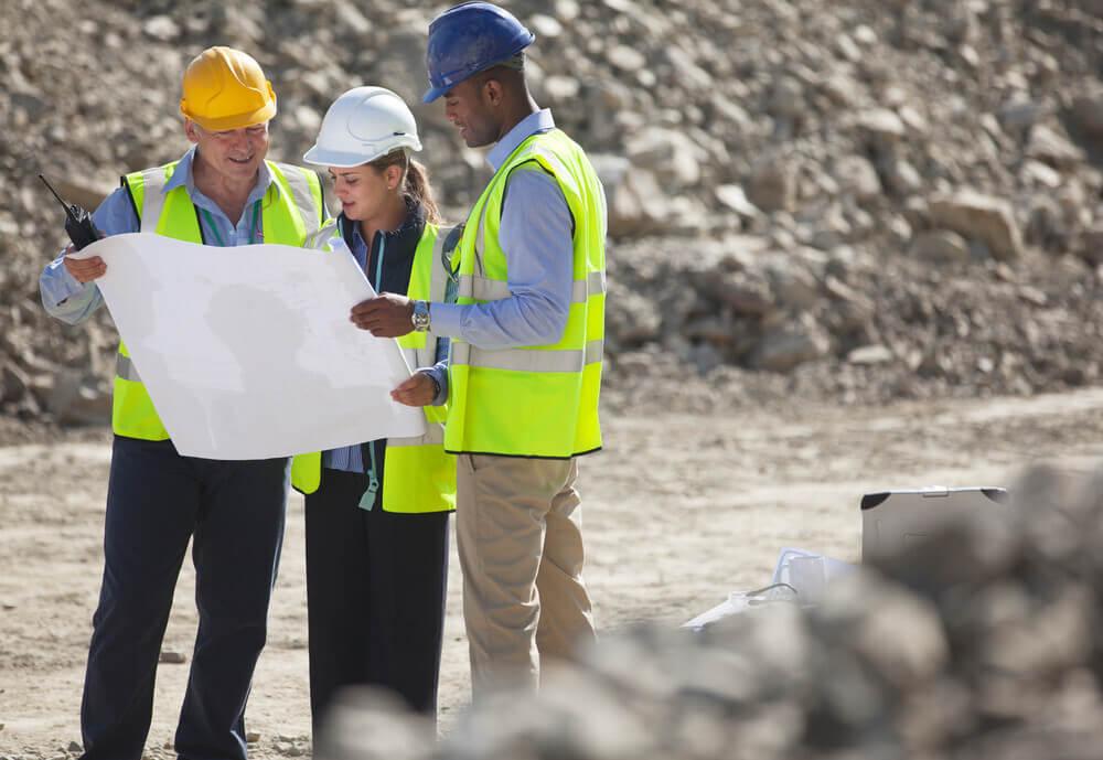 Team members discussing excavation & grading