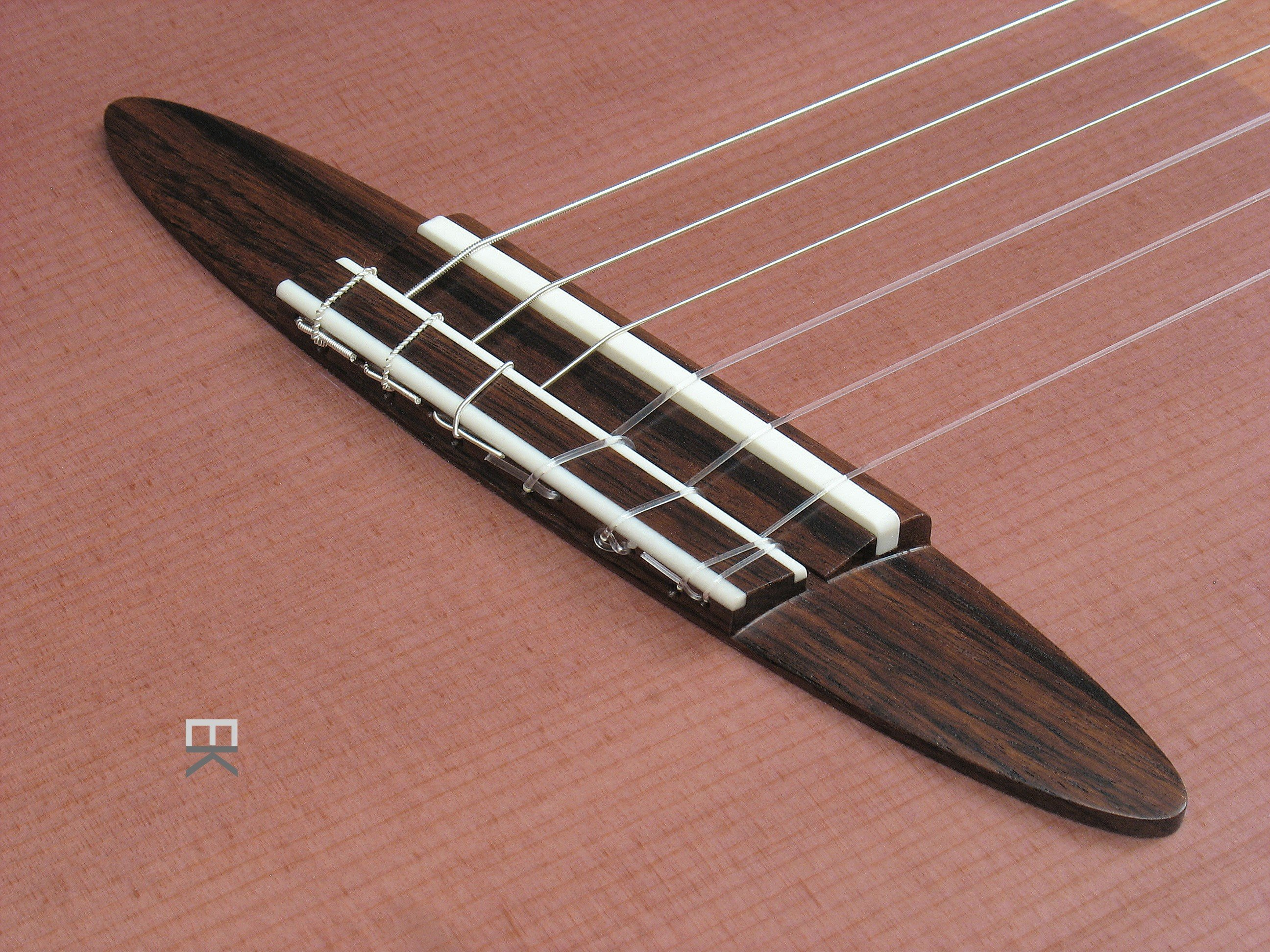 Rosewood bridge with twelve hole tie block