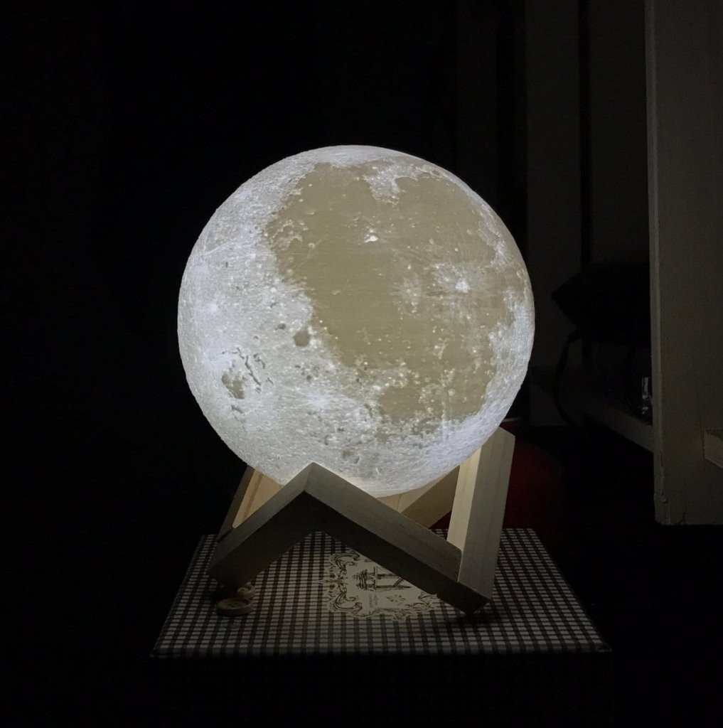 About This Product:  The moon has been a divine and enchanting symbol in human history, and it brings you mystery, delight, belief and romance. Decorate your own world with this beautiful moon light - cast a gentle glow over your desk or bedside table.  Main Features: - Charging port and switch integration: simple, beautiful and practical, easy to operate. - Warm and gentle LED lights: touch the metal ring to switch the color and turn off the light. - After the full charge, the lamp can be used 8-30 hours, a full charge takes about 6-8 hours.   How to Use:  1. Touch the metal ring at the bottom of the moon lamp to turn on / off the and change color from white to yellow.  2. Long press the metal ring to adjust the brightness, and it has the brightness memory function.  3. Insert the DC connector into the metal ring at the bottom of the moon lamp to charge, the red light is always on during the charging.  4. The red light will automatically turn off when fully charged.