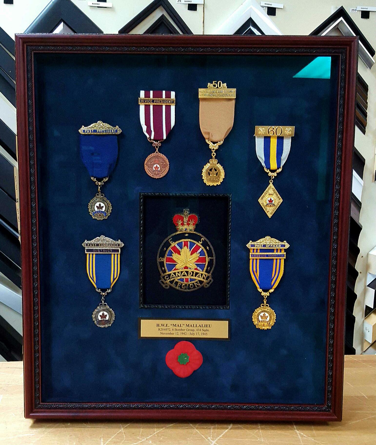 https://0901.nccdn.net/4_2/000/000/038/2d3/mallalieu-medals-1542x1824.jpg