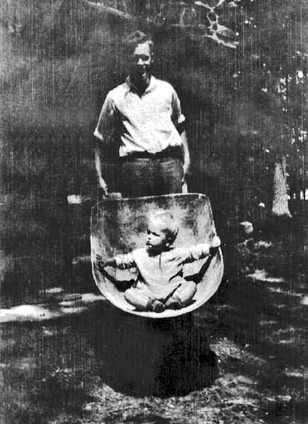 Some photos of people in Trail's End. This is Robert Cleaves Saunders (sr), with Jr. in the wheelbarrow