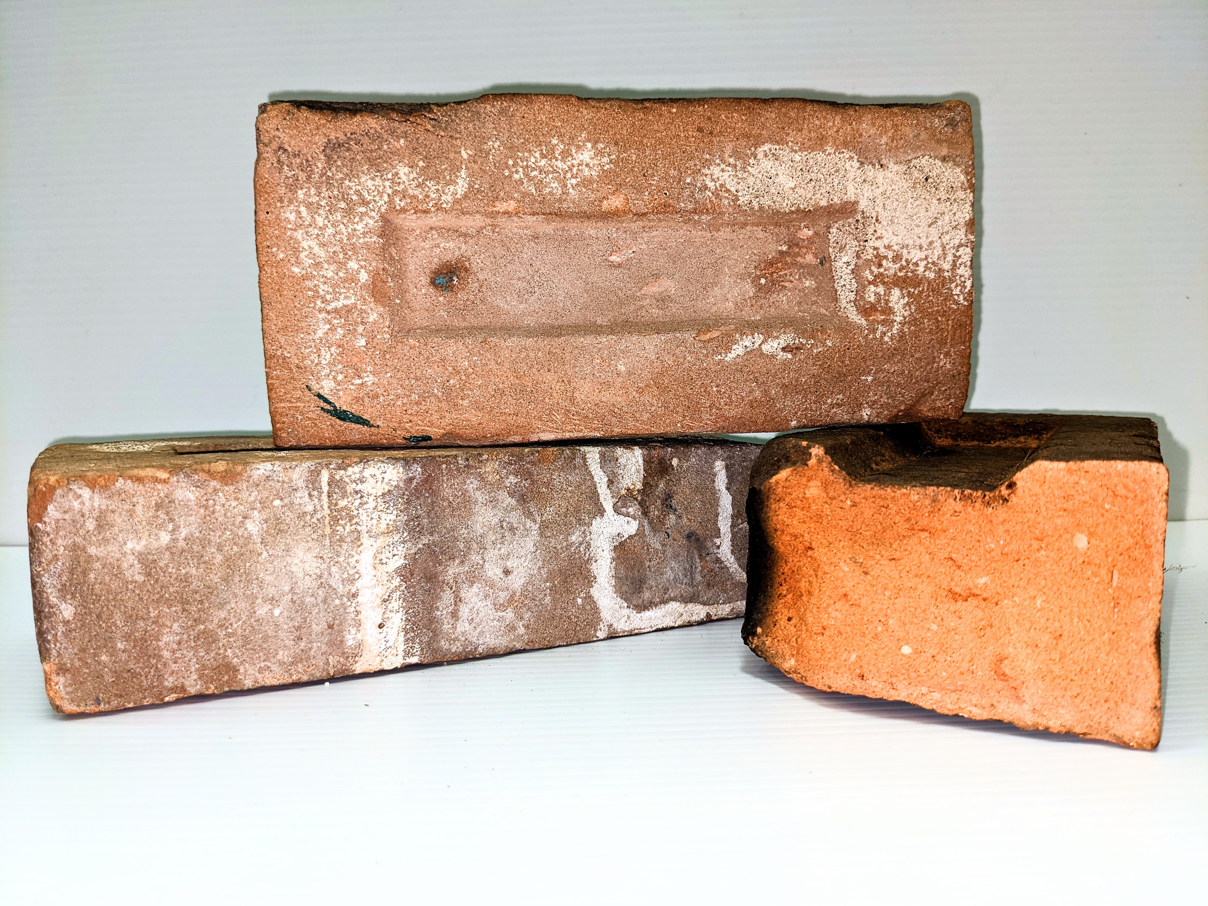 These bricks were made locally in Fort Vermilion! The Carruthers family owned and operated a brickyard on the outskirts of Fort Vermilion. Operational from 1903-1905, it was the most northern brickyard in Alberta and produced bricks for local construction and settlements further north such as Hay River. The Old Bay House and Clarke House chimneys are made with bricks from this yard.  05/04/2021 2009.5.1 / Toews, Marilee 986.2 / Bell, Lorna