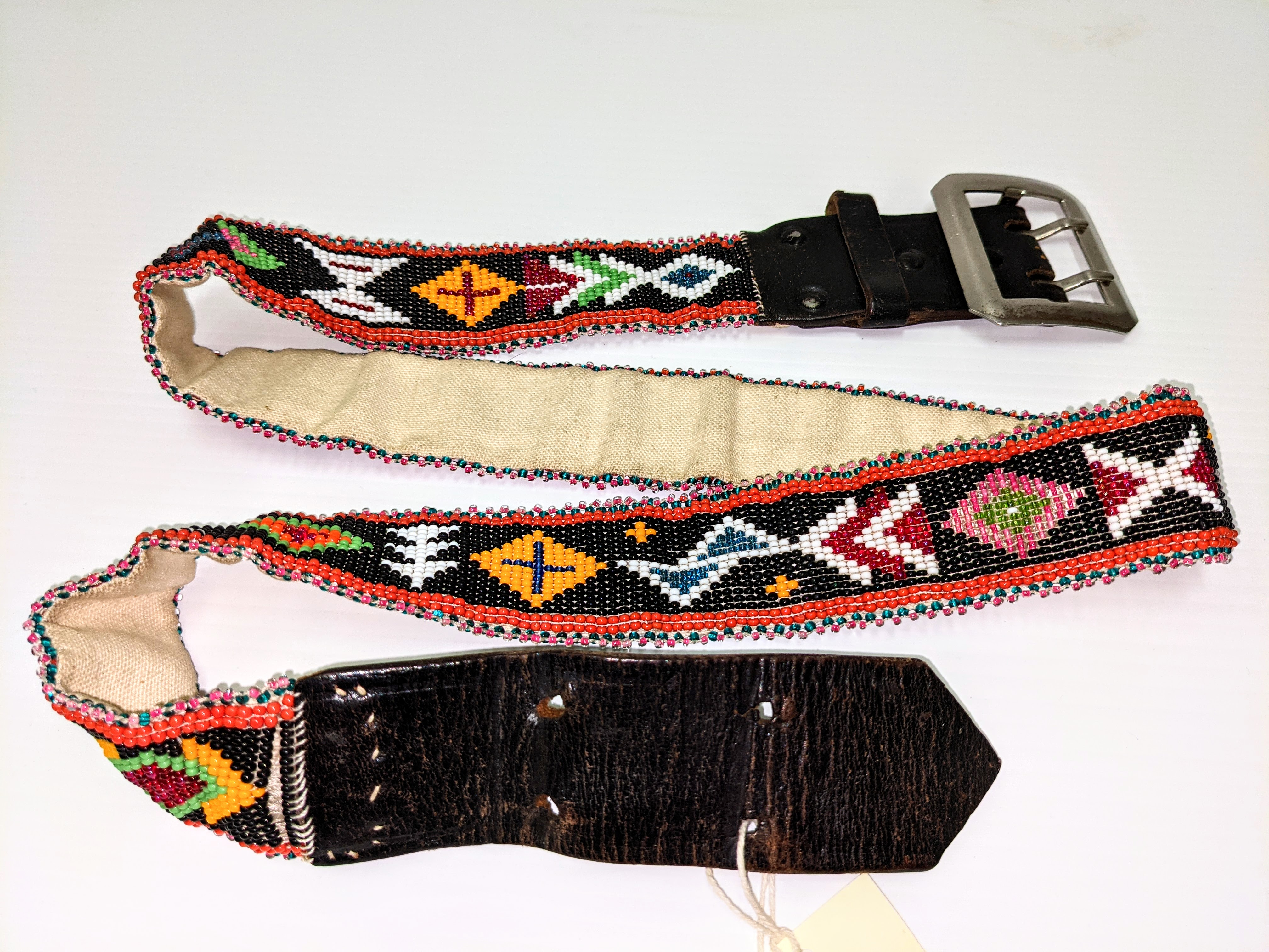 Although we do not have information on the artisan or the age of this beautiful artifact, the composition of the piece make it very interesting. First you will notice the incredibly uniform and intricate beadwork - typical of many indigenous artists. Upon further inspection you can see that the belt itself is not made of leather but rather canvas. This was likely done for ease of beading - though it is possible that the artist recycled a broken belt using the hardware and leather of either end. Recycling and reusing everything from building materials, to beads has long been practiced in Fort Vermilion and is part of what has allowed the settlement to prosper since 1788!  24/05/2021 2005.44.08 / Randolph, Helen
