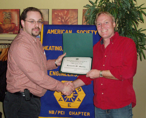 Chapter President Kevin Clannon (L) presents Ken Martin with an ASHRAE Service Award at the January Chapter Meeting