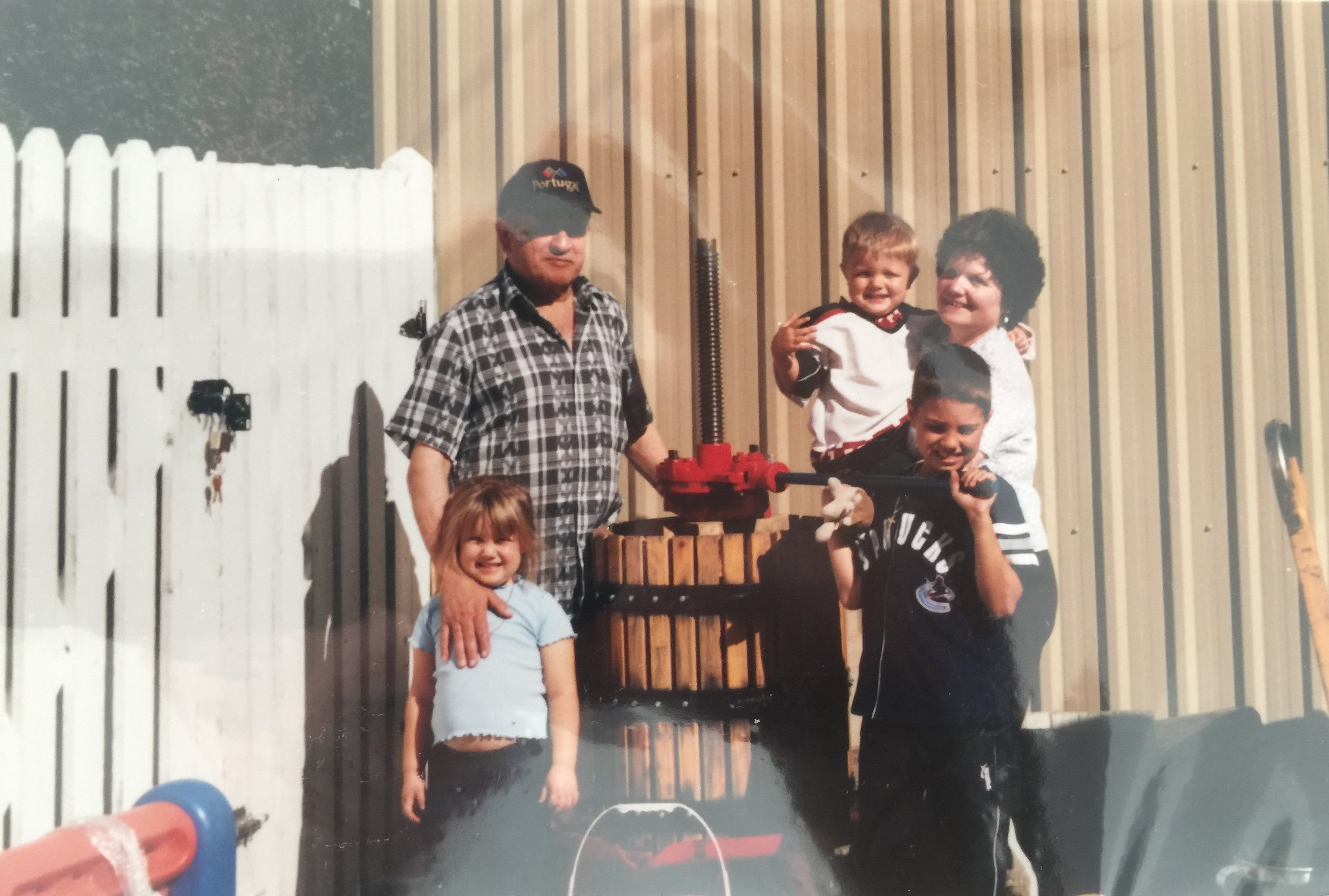Manuel and Filomena with grandchildren grape pressing