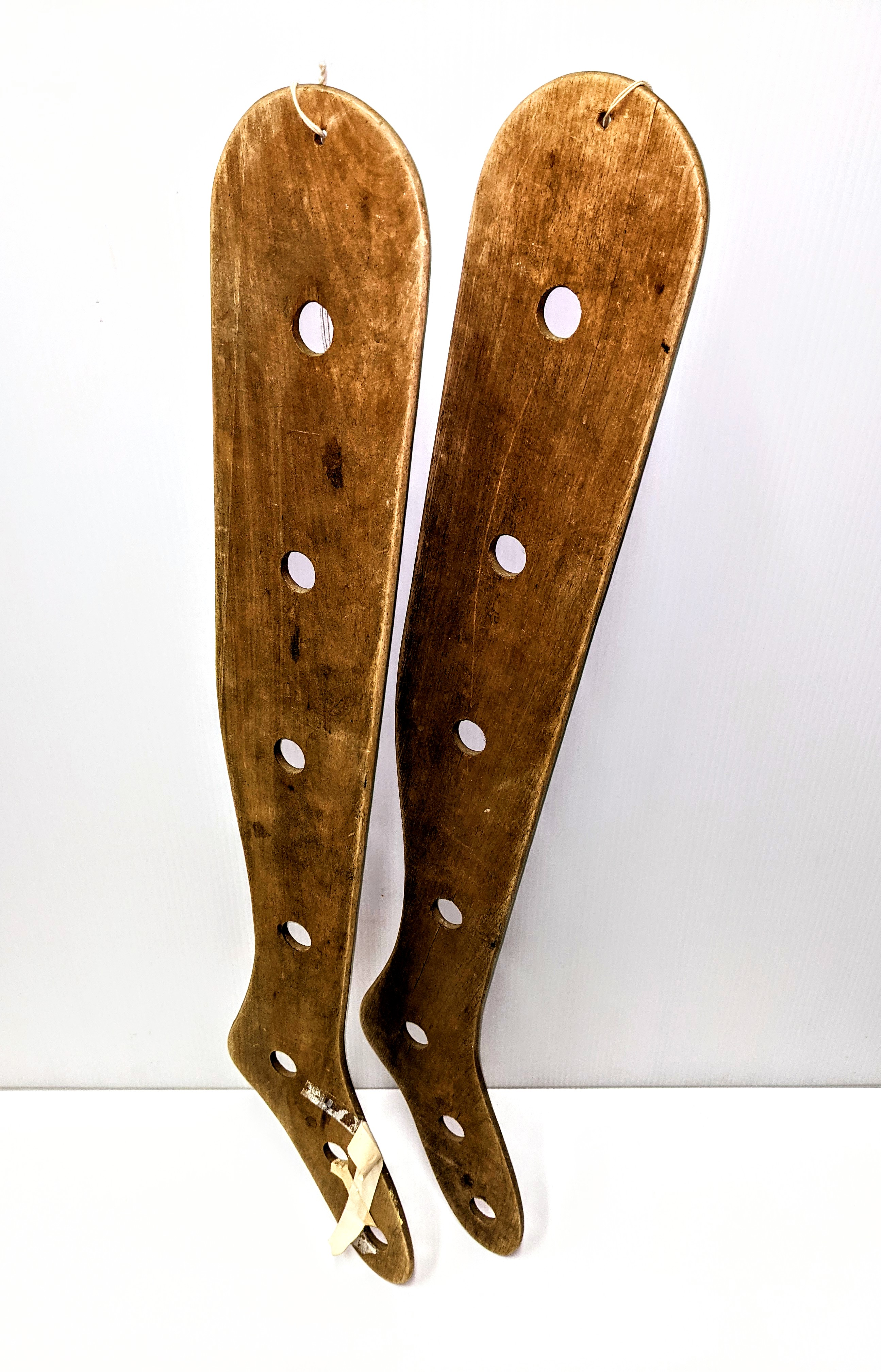 An uncommon sight in todays world of 'fast fashion', these sock stretchers were a household item in the early 20th century. Standing at 3ft tall, these particular stretchers would prevent knee high wool socks and stockings from shrinking after washing. The holes in the middle allowed airflow for drying and the contoured shape ensured the socks would maintain an excellent fit.  22/03/2021 998.01.01.1+2 / Newman, Jack & Pearl