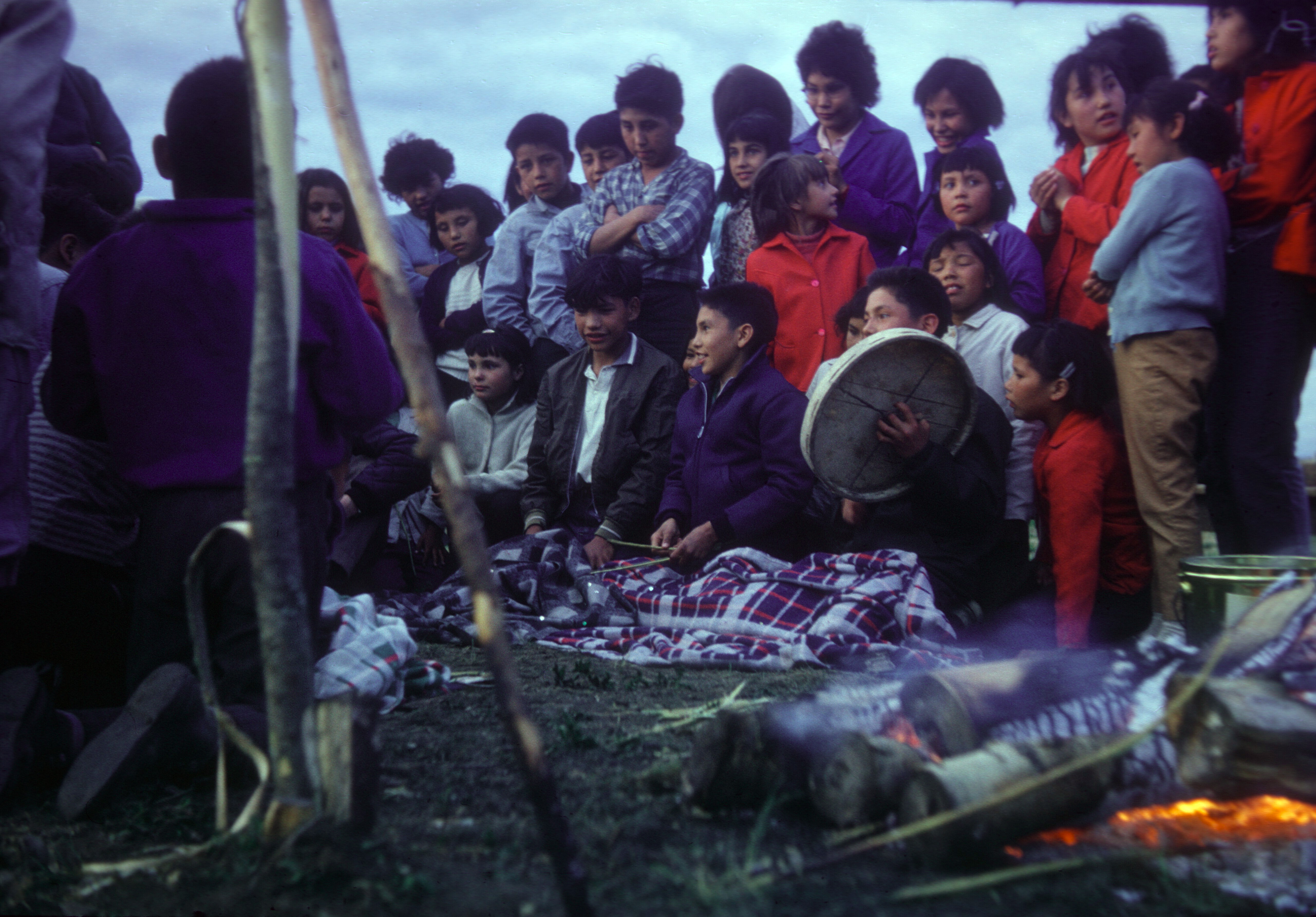 Playing hand games at the Residential School tea dance. 1966 Photo Credit: Anthony  O'Carroll.