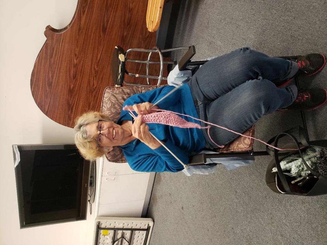Rita social distancing while knitting a head band.