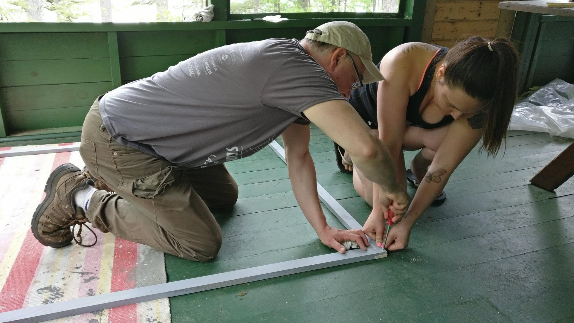 Clint and Emily piecing the frames together.