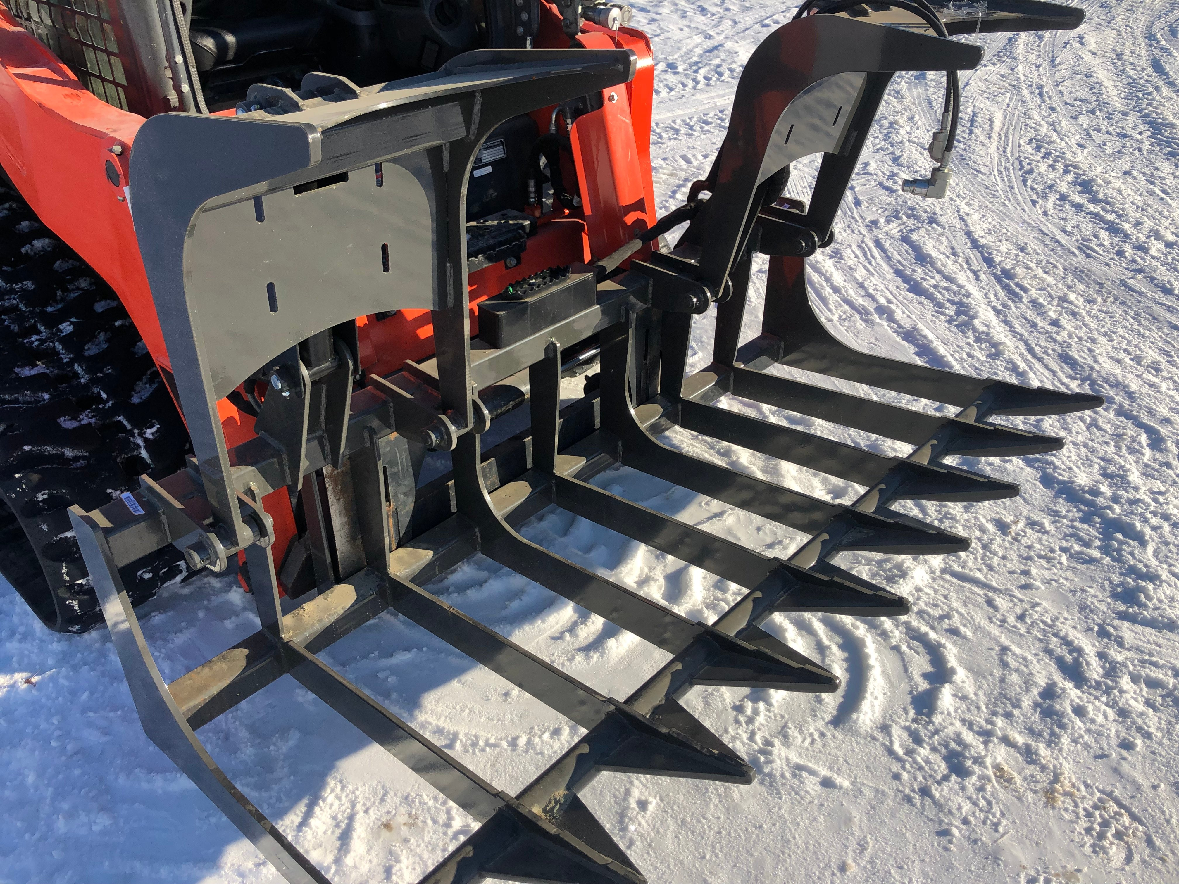 Root and tree grapple.  A must have item for handling trees, logs, and roots.  Available in various widths to suit your machine and needs.  Requires only standard flow auxiliary hydraulics.