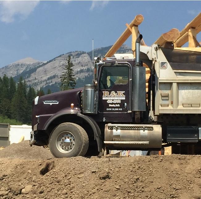 https://0901.nccdn.net/4_2/000/000/046/6ea/gravel-truck-651x643.jpg