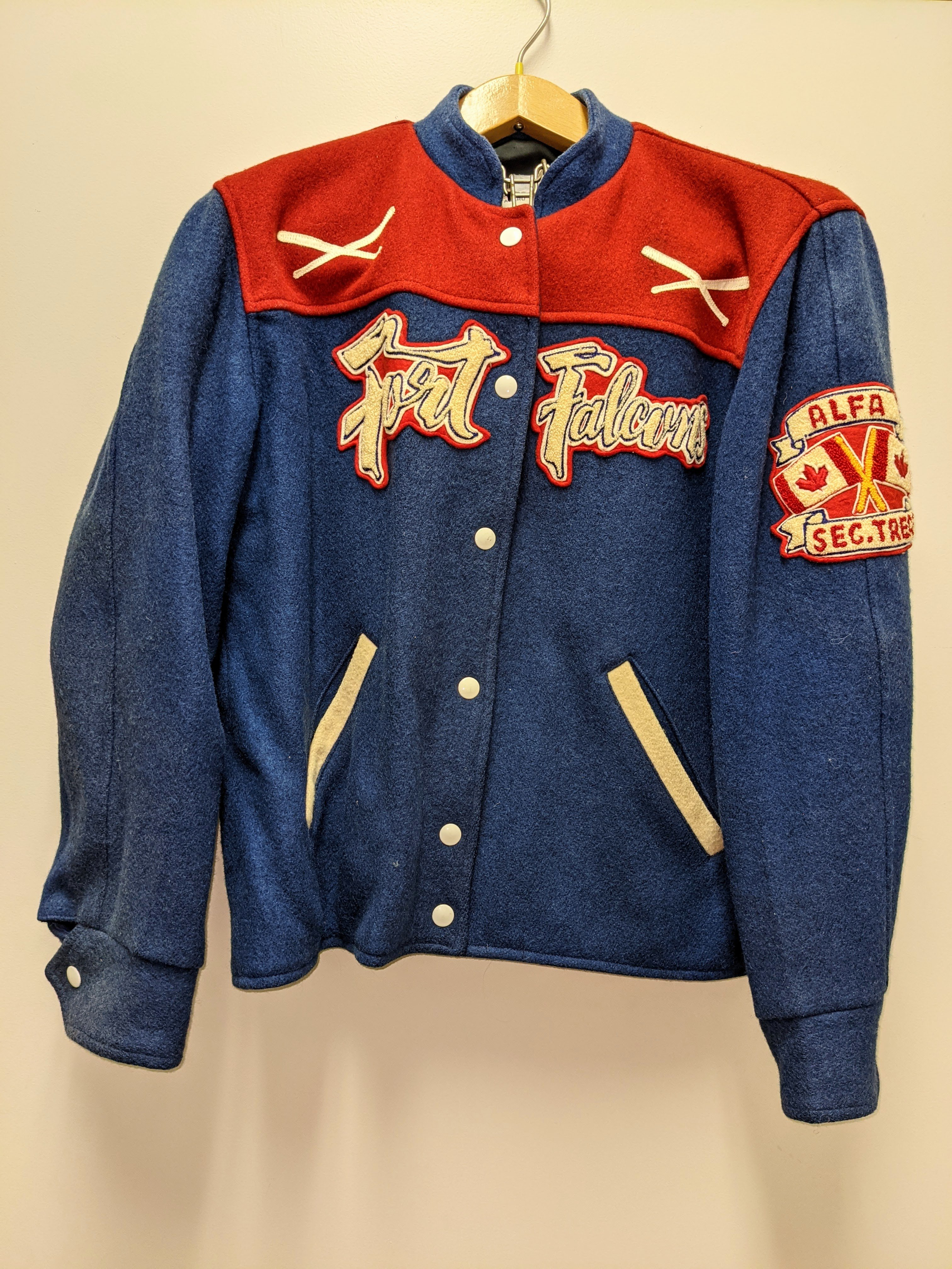 """A 1968 bomber jacket of the """"Fort Falcons"""" Baseball team is our artifact of the week! This jacket was owned by Alfa Twidale -as notated in the crest on the left sleeve. Alfa was the Secretary / Treasurer of the team in 1968. Competitive baseball has been enjoyed by Fort Vermilionaires for over a century. The earliest teams made up of neighbours from each locale  (Stony Point, Buttertown, Fort Vermilion) and played on grassy meadows!  30/08/2021 2004.03.138 / Twidale, John + Alfa"""