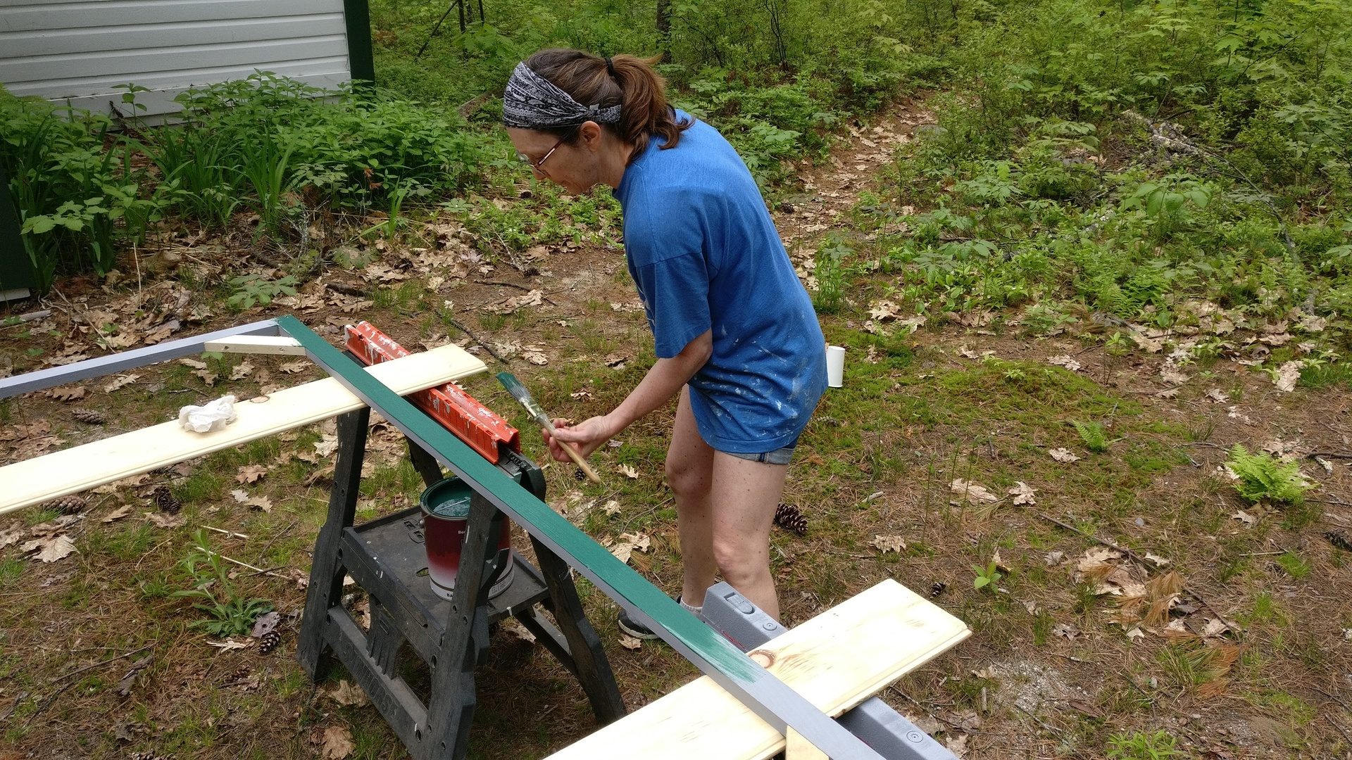 Lorrie painting the frames.