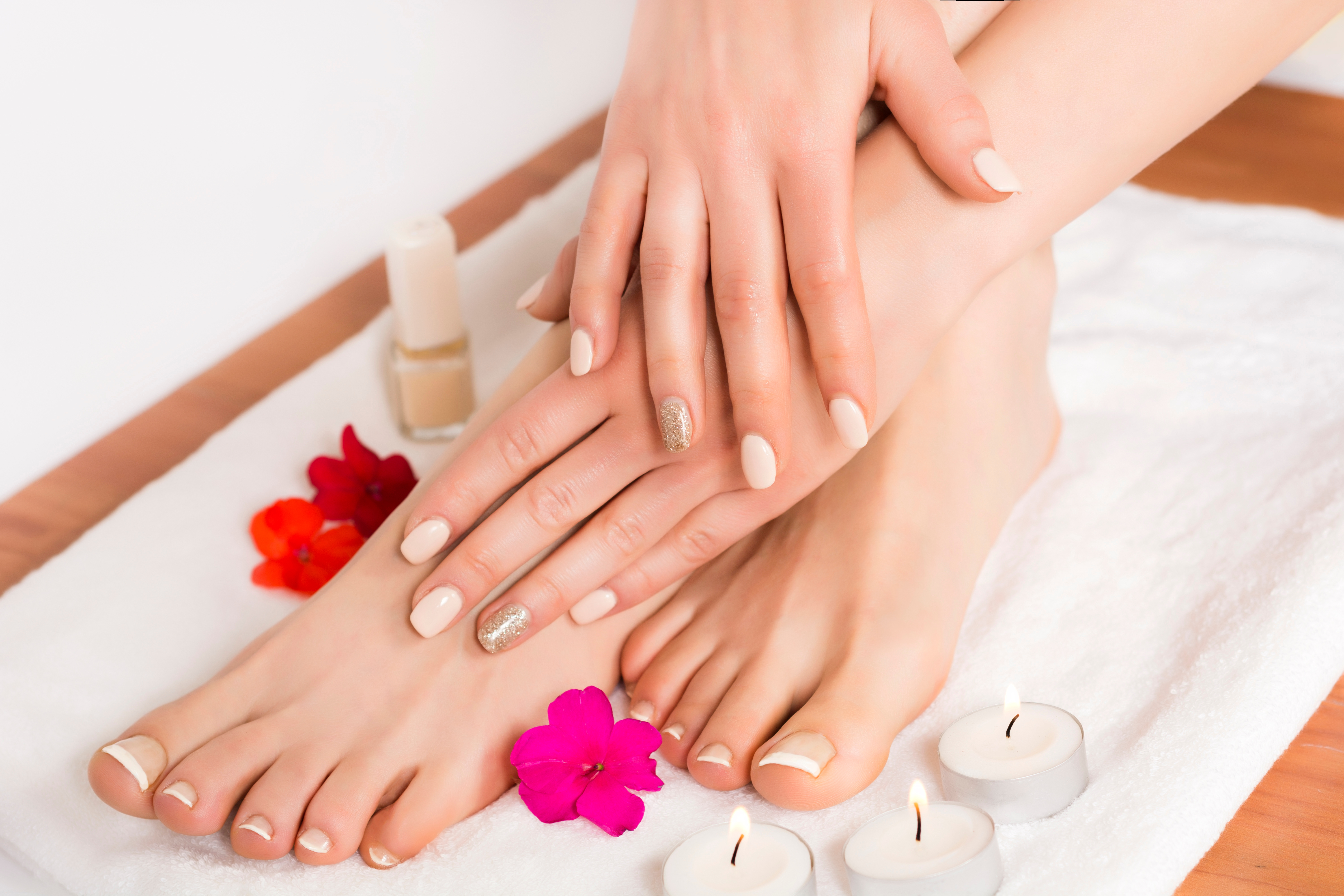 https://0901.nccdn.net/4_2/000/000/04d/add/Canva---Beauty-female-feet-and-hands-at-spa-salon-on-pedicure-procedure-and-flowers-and-candles-on-white-towel-6000x4000.jpg
