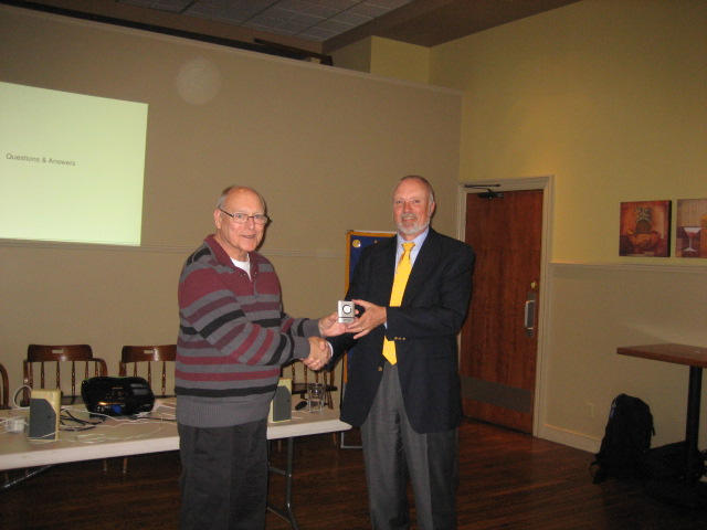 Dwight Scott 2012/2013 President presenting memento to Distiguished Lecturer Hoy Bohanon at the April 2013 meeting