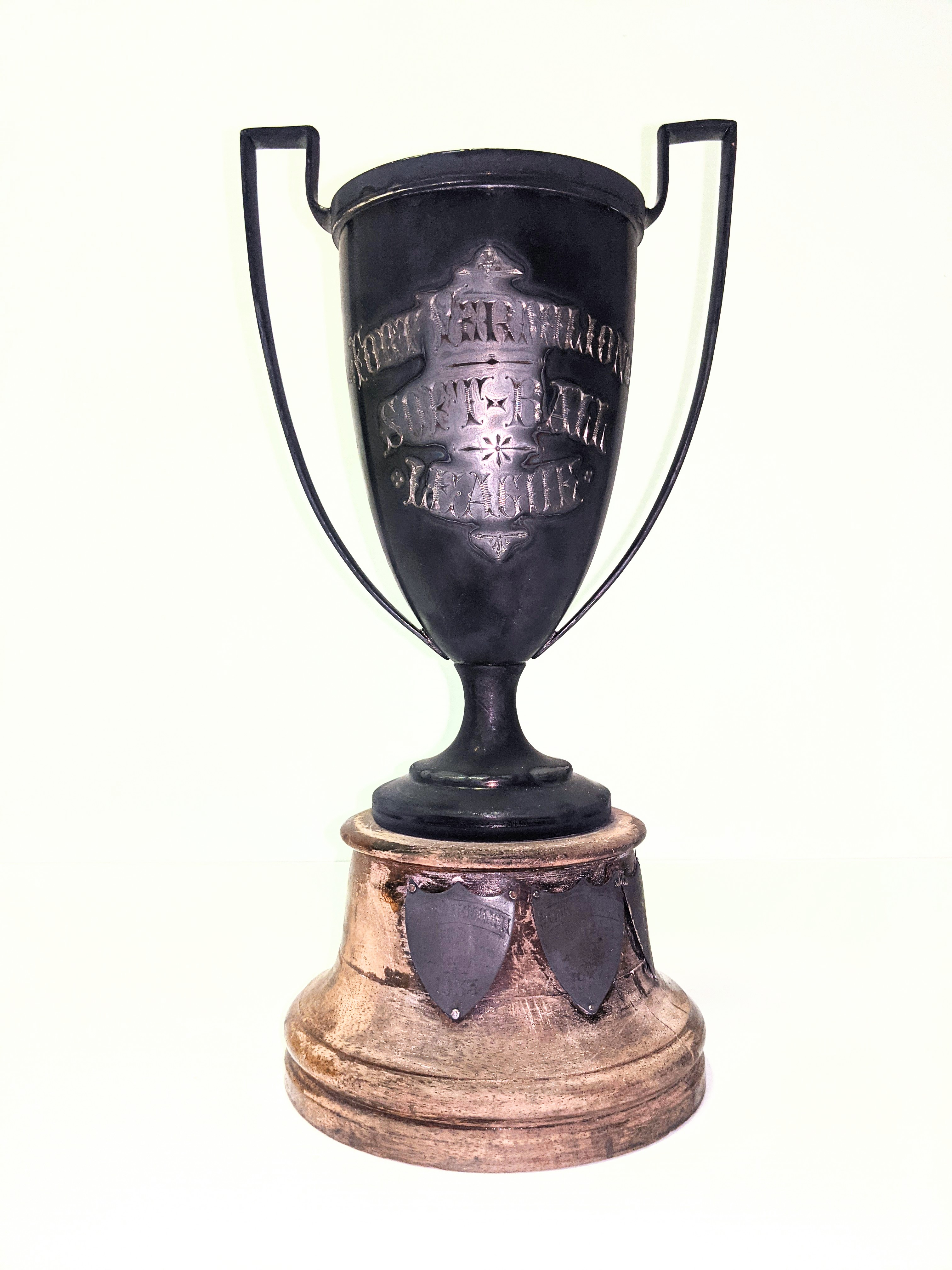 """This is a sterling silver trophy (that badly needs polishing) for the """"Fort Vermilion Soft Ball League"""". The 3 crests at the bottom detail """"Fort Vermilion Softball Club"""" as champions in 1933 and """"Stoney Point Softball Club"""" as champions in 1934 + 1935. The original price of the trophy is noted on the bottom as $15.25  15/02/2021 2000.18.09 / Jones, Art"""