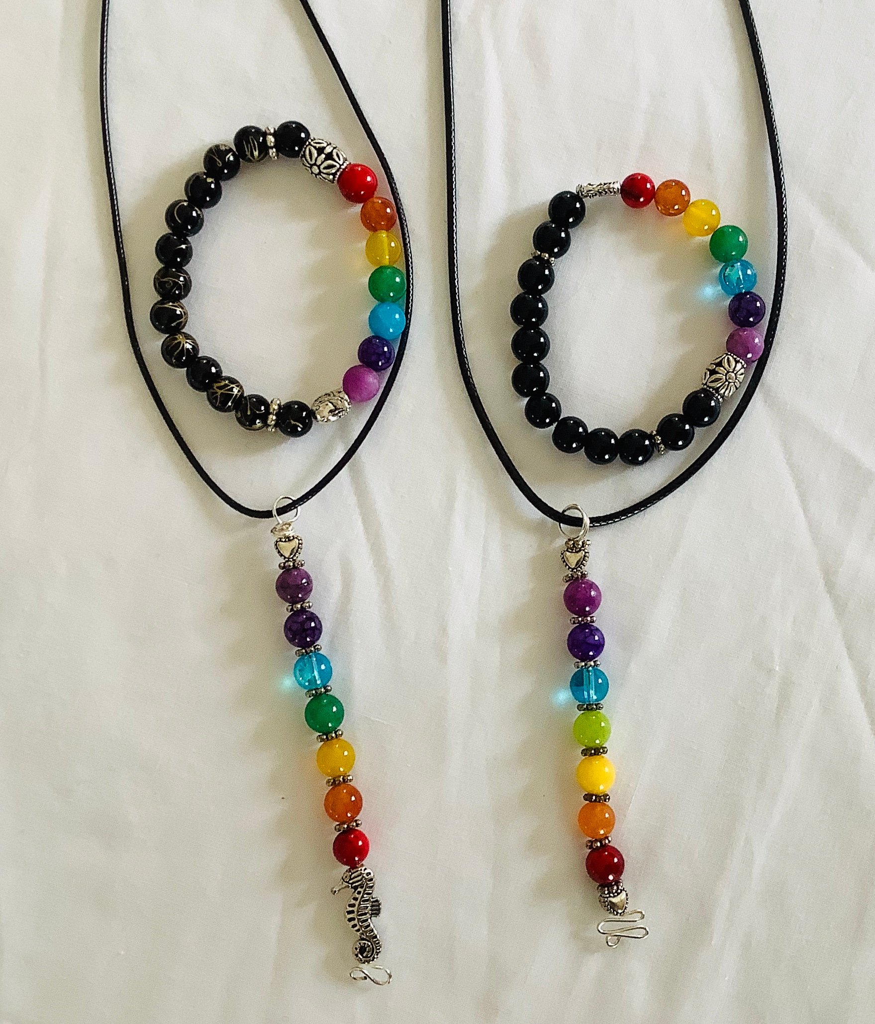 Chakra Pendants and Bracelets. Each piece has the color of each chakra, seven in all, red, orange, yellow, green, blue, purple and light purple.  They are known to be the centers of spiritual power in the human body.  Pendant $20.00 Bracelet $20.00
