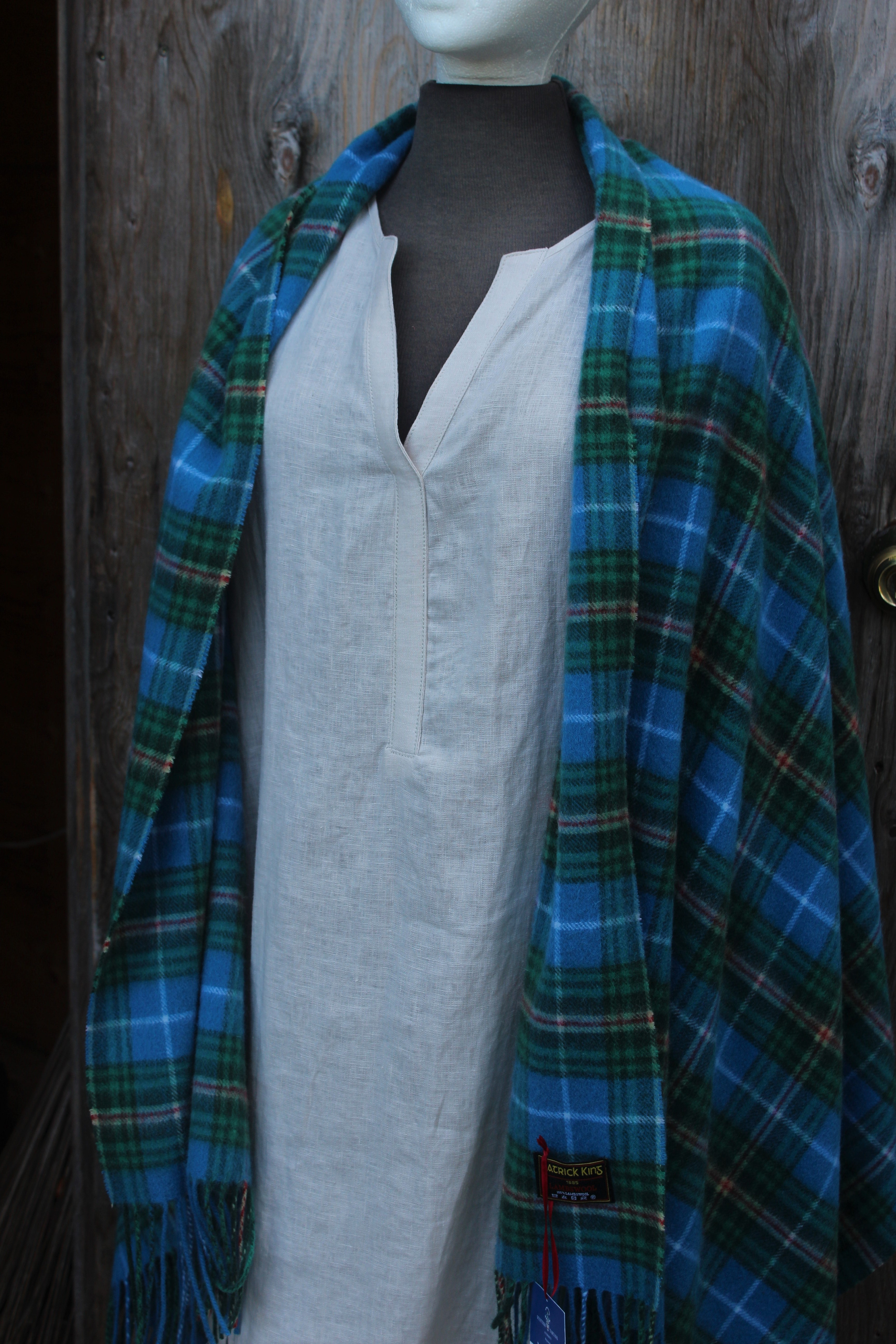 Nova Scotia Tartan Cape- $136.00 100% Lambswool, Made in Scotland Featuring Beige Linen Dress- $88.00