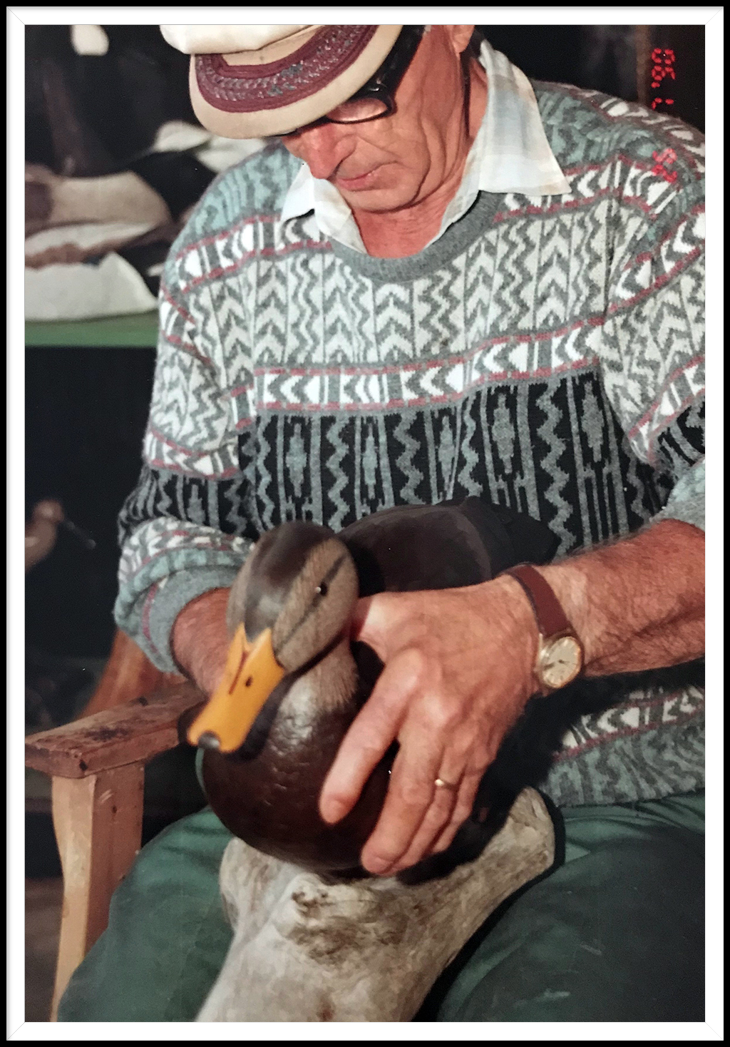 Lincoln Harvey carving a duck decoy